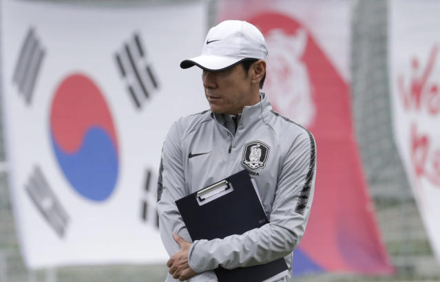 South Korea's head coach Shin Tae-yong watches his players during a training session of South Korea at the 2018 soccer World Cup at the Spartak Stadium in Lomonosov near St. Petersburg, Russia, Friday, June 15, 2018. (AP Photo/Lee Jin-man)