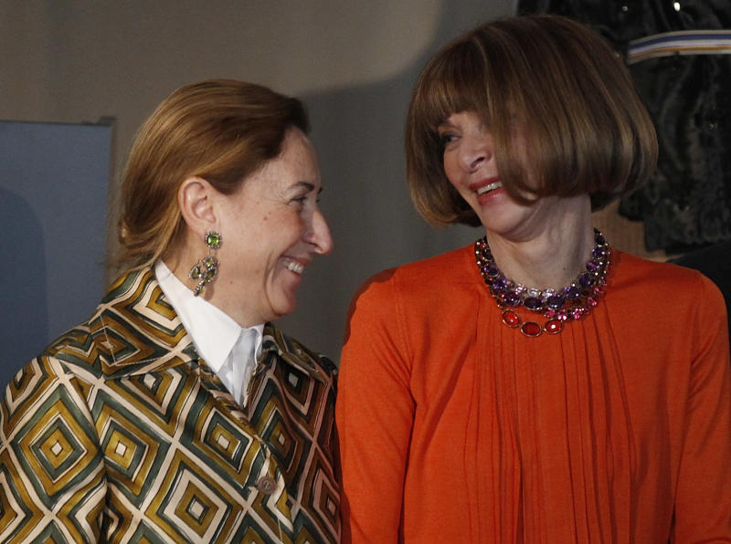 "American Vogue's editor-in-chief Anna Wintour, right, talks to Italian fashion designer Miuccia Prada during the presentation of the fashion exhibition ""Impossible Conversations"" in Milan, Italy, Friday, Feb.24, 2012. The exhibition will take place at the Metropolitan Museum of Art in New York, from May 10 to August 19, 2012. (AP Photo/Luca Bruno)"