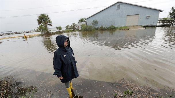 PHOTO: Cheryl Conners looks over flood waters surrounding Langs Marina near her home during Hurricane Dorian, Sept. 4, 2019, in St. Mary's, Ga. (Curtis Compton/Atlanta Journal-Constitution via AP)