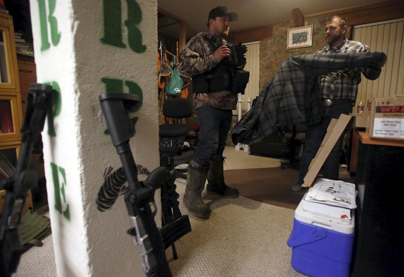 Ammon Bundy (R) talks with Wes Kjar in an office at the Malheur National Wildlife Refuge near Burns, Oregon, January 6, 2016. Saturday's takeover of the Malheur National Wildlife Refuge outside the town of Burns, Oregon, marked the latest protest over federal management of public land in the West, long seen by conservatives in the region as an intrusion on individual rights. REUTERS/Jim Urquhart
