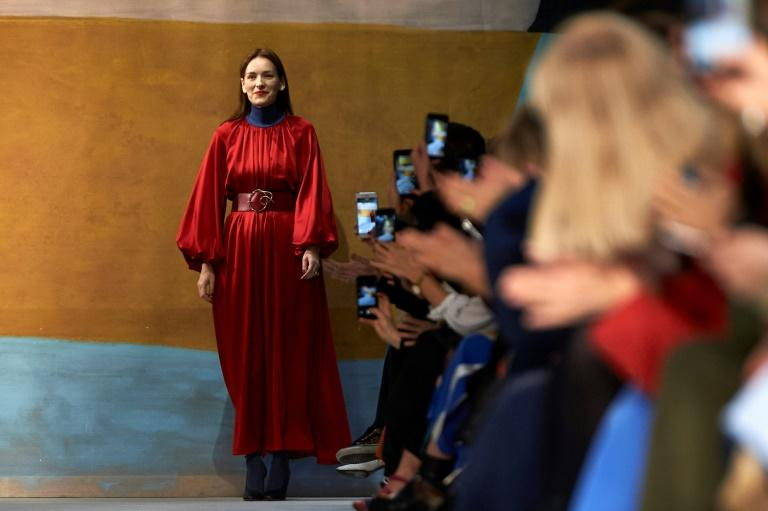 Serbian designer Roksanda Ilincic greets the audience at the end of her catwalk show at London Fashion Week
