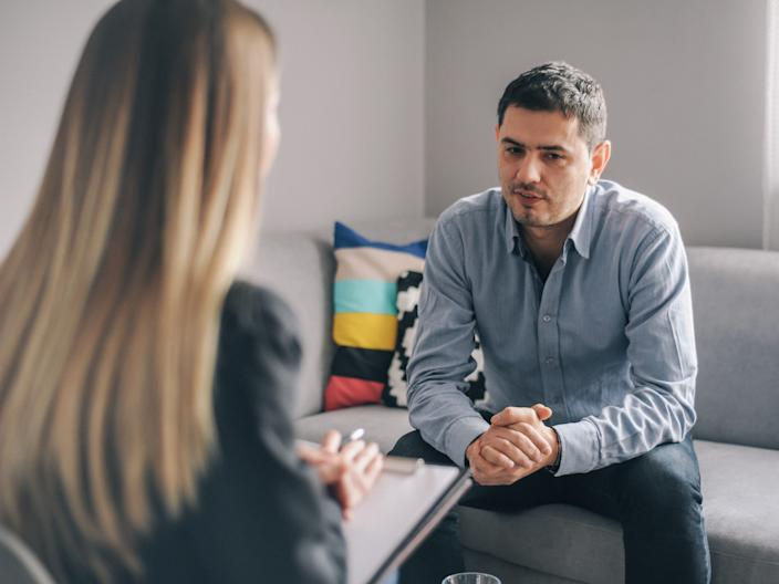A man speaking to a counselor.