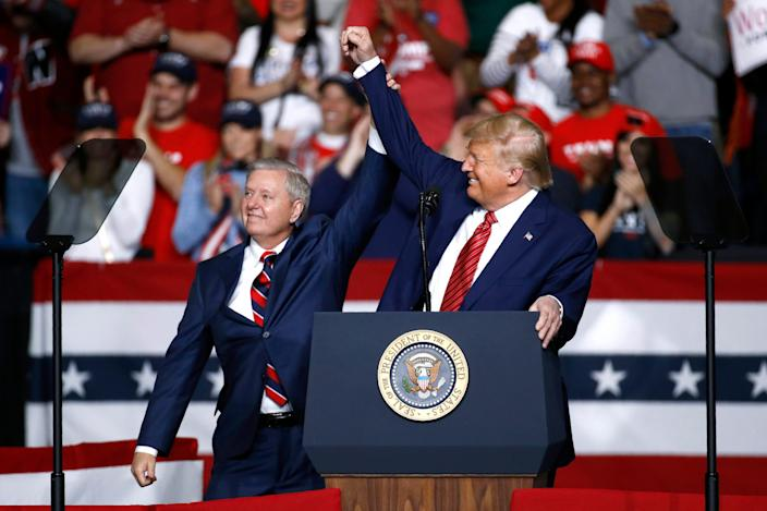 FILE - In this Feb. 28, 2020 file photo, Sen. Lindsey Graham, R-S.C., left, stands onstage with President Donald Trump during a campaign rally, in North Charleston, S.C. Jaime Harrison has raised more money than his Republican opponent, Sen. Lindsey Graham, two quarters in a row. (AP Photo/Patrick Semansky, File) ORG XMIT: WX202