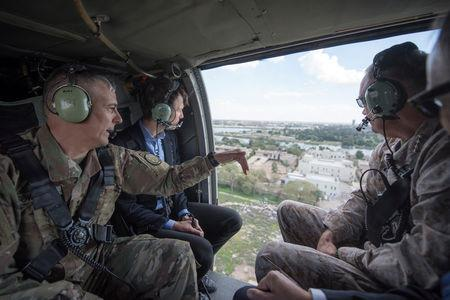 Jared Kushner (middle), Senior Advisor to President Donald J. Trump, is pictured during a helicopter transit over Baghdad, Iraq, in this April 3, 2017 handout photo. Navy Petty Officer 2nd Class Dominique A. Pineiro/DoD/Handout via REUTERS