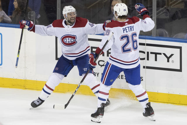 Montreal Canadiens center Nate Thompson (44) celebrates his goal with defenseman Jeff Petry (26) during the third period of an NHL hockey game against the New York Rangers, Friday, Dec. 6, 2019, at Madison Square Garden in New York. The Canadiens won 2-1. (AP Photo/Mary Altaffer)