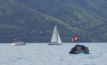 Boats line up on Leman Lake to reveal the invisible French-Swiss border, near Geneva