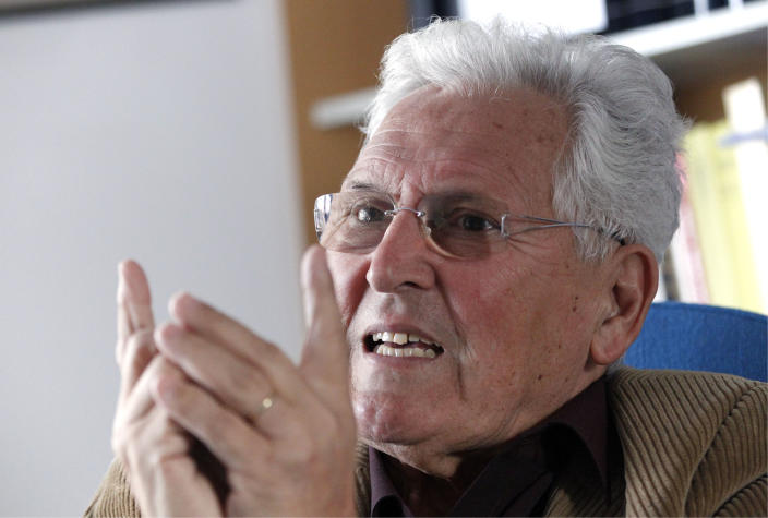 Sociology professor Niko Tos talks during an interview in Ljubljana, Slovenia, Tuesday, Sept. 25, 2012. Tos said the current Slovenian crisis is the result of such an ownership transition.(AP Photo/Darko Bandic)