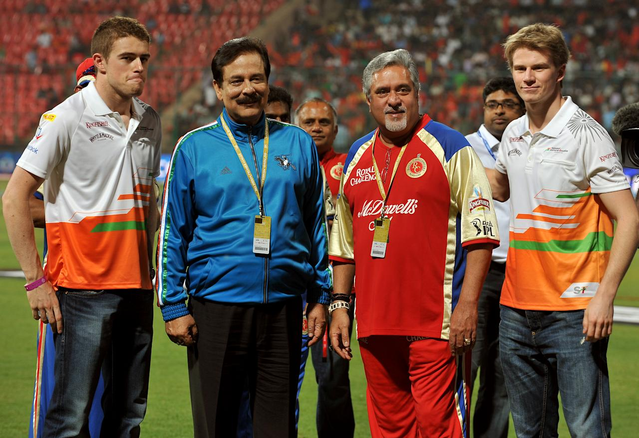 (L-R) Sahara Force India driver Paul di Resta, owner of Sahara Group of companies, Sahara Force India formula car racing team and Pune Warriors team owner Subroto Roy Sahara, UB Group Chairman and owner of RCB team Vijay Mallya and Shara Force India driver Nico Hulkenberg pose for a photograph prior to the IPL Twenty20 cricket match between Royal Challengers Bangalore and Pune Warriors at the M. Chinnaswamy Stadium in Bangalore on April 17, 2012.    RESTRICTED TO EDITORIAL USE. MOBILE USE WITHIN NEWS PACKAGE.    AFP PHOTO/Manjunath KIRAN (Photo credit should read Manjunath Kiran/AFP/Getty Images)