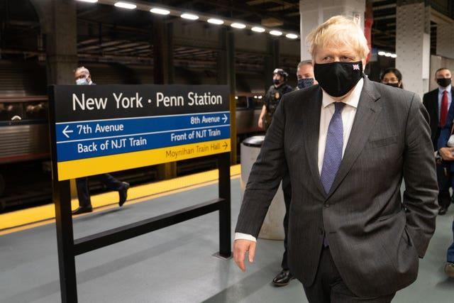 Prime Minister Boris Johnson prepares to board a train from Penn Station in New York to Washington DC (Stefan Rousseau/PA)