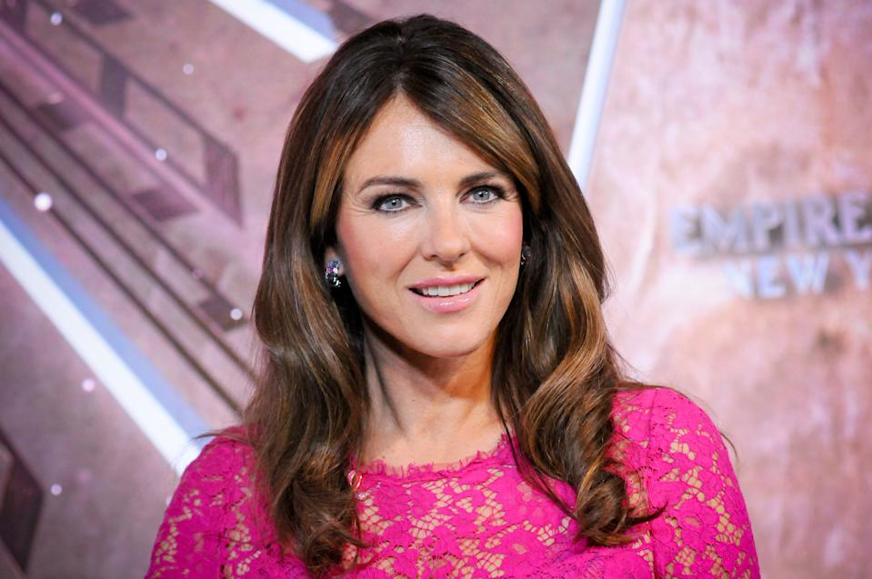 Elizabeth Hurley attends the lighting ceremony in honor of Esteé Lauder Companies' 2019 Breast Cancer Campaign. (Photo: Getty Images)