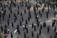Ultra-Orthodox Jews keep social distance amid concerns over the country's coronavirus outbreak, during a protest to what they say is incitement against the city and country's religious population, in the southern Israeli city of Arad, Monday, Oct 19, 2020. Ultra-Orthodox communities have been hard hit by the coronavirus, in part because of their refusal to honor public safety rules, sparking widespread anger and criticism. (AP Photo/Oded Balilty)