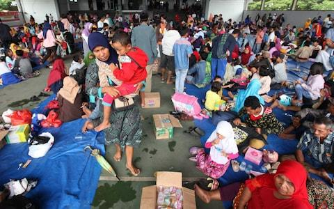 Residents evacuate from Sebesi Island at Tennis Court Kalianda in South Lampung, Indonesia on December 26, 2018 - Credit: Andalou