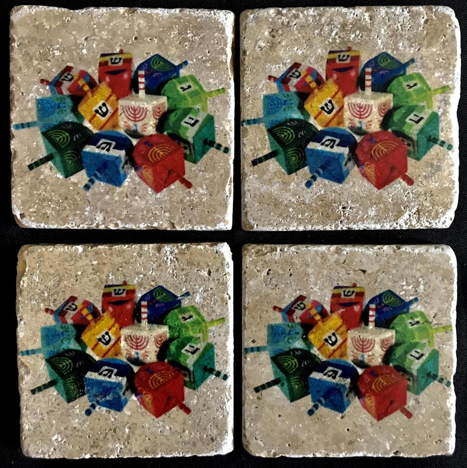 "Dreidel, dreidel, dreidel, these <em>aren't</em> made out of clay (sorry, had to). These colorful dreidel coasters are made out of Travertine natural stone with cork on the back to protect furniture and a protective sealer for cold and hot beverages. $45, StarrBridge. <a href=""https://www.etsy.com/listing/570481813/dreidel-coasters"" rel=""nofollow noopener"" target=""_blank"" data-ylk=""slk:Get it now!"" class=""link rapid-noclick-resp"">Get it now!</a>"