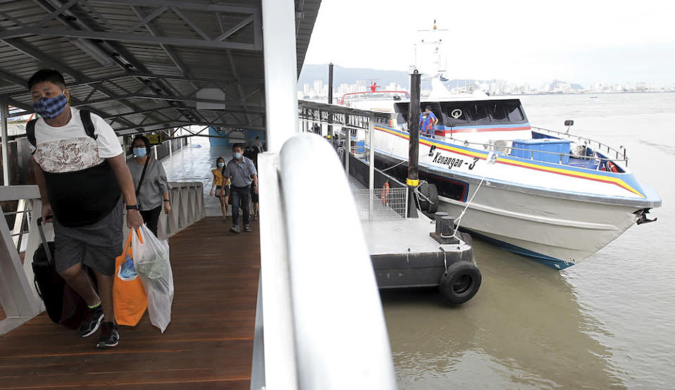 Passengers disembarking after their journey on the new speedboat from Swettenham Pier to Pengkalan Sultan Abdul Halim Ferry Terminal, January 1, 2021. — Picture by Sayuti Zainuddin