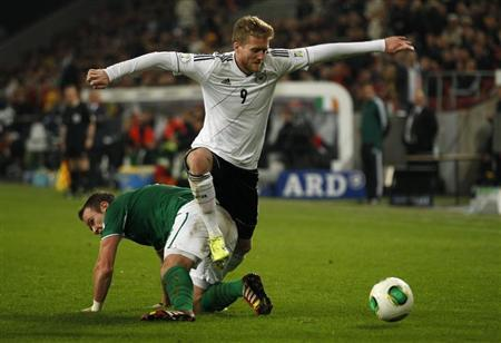 Ireland's Whelan challenges Germany's Schuerrle during their 2014 World Cup qualifying soccer match in Cologne