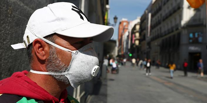 A man wears a mask on Preciados Street in central Madrid on Friday.