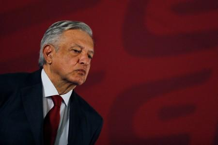 Mexican president Andres Manuel Lopez Obrador looks on during a news conference at National Palace in Mexico City