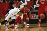Cincinnati guard Deshaun Morman (1) goes after a loose ball against Stony Brook guard Carson Puriefoy (10) in the first half of an NCAA college basketball game, Tuesday, Dec. 2, 2014, in Cincinnati. (AP Photo/Frank Victores)