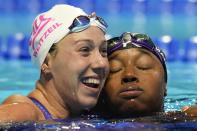 Simone Manuel and Abbey Weitzeil hug after the women's 50 freestyle during wave 2 of the U.S. Olympic Swim Trials on Sunday, June 20, 2021, in Omaha, Neb. (AP Photo/Jeff Roberson)