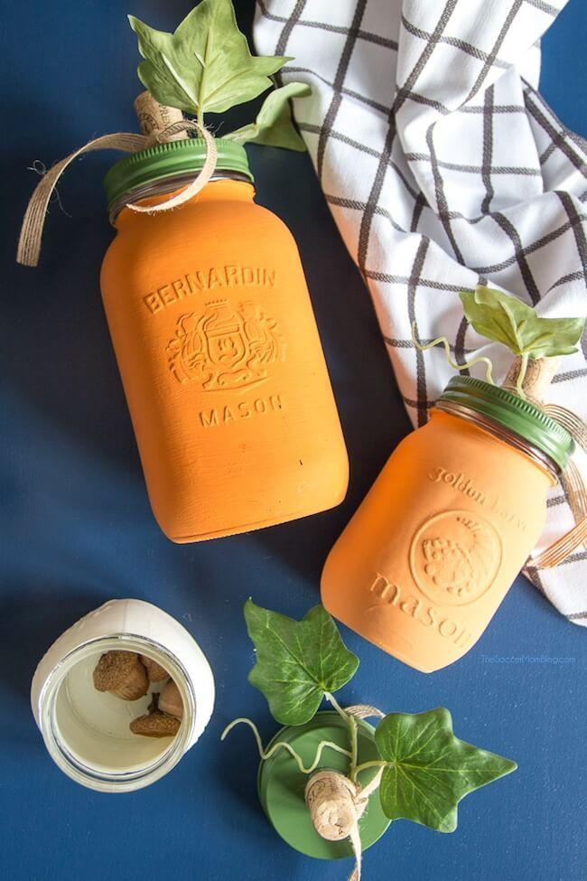"<p>What better way to send your guests home with leftovers than these mason jar pumpkins? All they take is some paint and whatever other decorations you want to add. <a href=""https://thesoccermomblog.com/mason-jar-pumpkins/"" rel=""nofollow noopener"" target=""_blank"" data-ylk=""slk:The Soccer Mom Blog"" class=""link rapid-noclick-resp"">The Soccer Mom Blog</a> used corks and acorns to mimic a pumpkin stem on the lid. </p><p><a class=""link rapid-noclick-resp"" href=""https://go.redirectingat.com?id=74968X1596630&url=https%3A%2F%2Fwww.michaels.com%2F6-count-8oz-plastic-mason-jars-by-craft-smart%2F10537338.html&sref=https%3A%2F%2Fwww.delish.com%2Fholiday-recipes%2Fthanksgiving%2Fg33808794%2Fthanksgiving-decorations%2F"" rel=""nofollow noopener"" target=""_blank"" data-ylk=""slk:BUY NOW"">BUY NOW</a> <em><strong>6-count mason jar pack, $5.99</strong></em><br></p>"