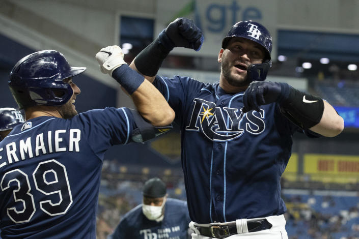 Tampa Bay Rays' Mike Zunino, right, celebrates with Kevin Kiermaier after hitting a two-run home run against the Detroit Tigers during the sixth inning of a baseball game Thursday, Sept. 16, 2021, in St. Petersburg, Fla. (AP Photo/Scott Audette)