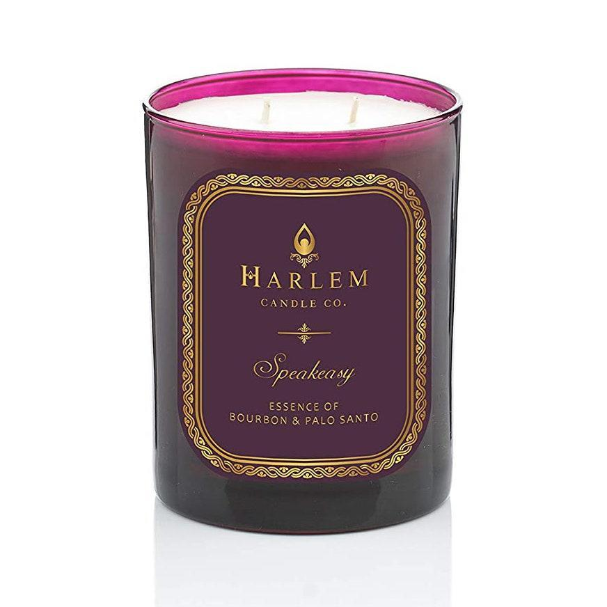 """Harlem Candle Co's jazz age-themed candles are elegant without the camp. Sophisticated notes of palo santo, bourbon, dark chocolate, and tobacco will make you feel like you just walked into a saloon, or as the candle suggests, a speakeasy. Its top notes also include cardamom and pimento berry, while its middle notes are saffron, licorice, and plum blossom. If you're going for impact, this candle is on the heavier side and you'll love every second of it while it's burning. $45, Harlem Candle Company. <a href=""""https://www.harlemcandlecompany.com/products/speakeasy-luxury-candle"""" rel=""""nofollow noopener"""" target=""""_blank"""" data-ylk=""""slk:Get it now!"""" class=""""link rapid-noclick-resp"""">Get it now!</a>"""