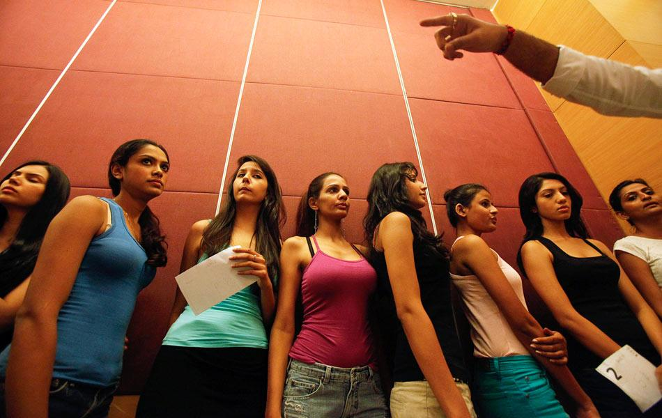 Aspiring models line-up to present themselves on a runway during auditions for the upcoming Lakme Fashion Week in Mumbai June 19, 2012. India's fashion and trade event will be held from August 3 to 7. REUTERS/Vivek Prakash