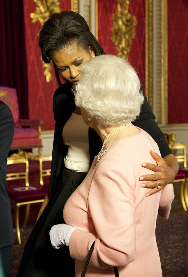 First lady Michelle Obama walks with Queen Elizabeth at a reception at Buckingham Palace on April 1, 2009. (ASSOCIATED PRESS)