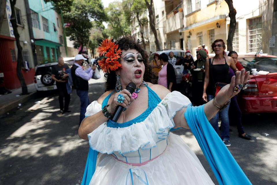 An activist sings during the celebration of gay pride on a street in a city neighborhood, although the Mexican LGBT community called for an online celebration as a protective measure amid the coronavirus disease (COVID-19) outbreak, in Mexico City, Mexico June 27, 2020