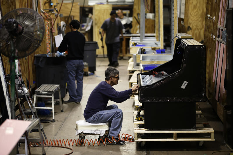 FILE - In this Oct. 18, 2018, file photo workers build refrigerators at the Howard McCray's commercial refrigeration manufacturing facility in Philadelphia. On Friday, June 14, 2019, the Federal Reserve reports on U.S. industrial production for April. (AP Photo/Matt Rourke, File)