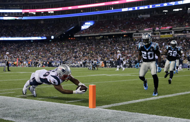 New England Patriots running back Shane Vereen (34) dives to the pylon for a touchdown in front of Carolina Panthers cornerback Antoine Cason (20) in the second half of an NFL preseason football game Friday, Aug. 22, 2014, in Foxborough, Mass. (AP Photo/Charles Krupa)