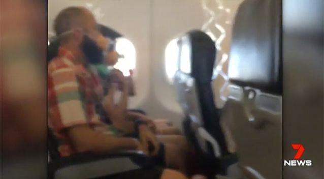 Terrified passengers were given oxygen masks. Source: 7 News