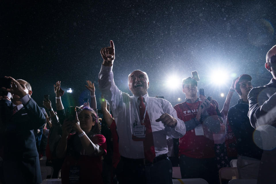 Supporters of President Donald Trump cheer as he arrives for a campaign rally at Harrisburg International Airport, Saturday, Sept. 26, 2020, in Middletown, Pa. (AP Photo/Evan Vucci)