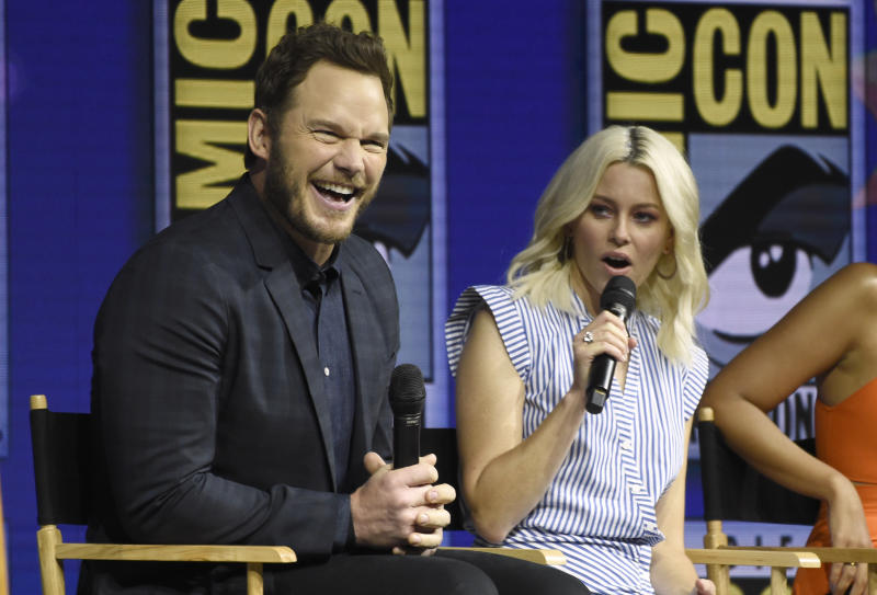 "Chris Pratt, left, reacts as Elizabeth Banks speaks at the Warner Bros. Theatrical panel for ""The Lego Movie 2: The Second Part"" on day three of Comic-Con International on Saturday, July 21, 2018, in San Diego. (Photo by Chris Pizzello/Invision/AP)"