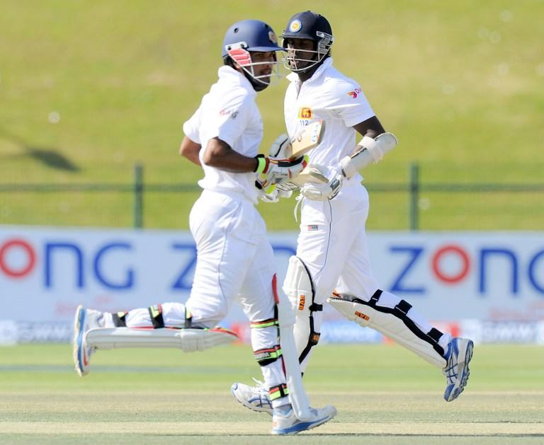 Sri Lankan batsmen Dinesh Chandimal (L) and  Angelo Mathews (R) run between the wickets during the fourth day of the first cricket Test match between Pakistan and Sri Lanka at the Sheikh Zayed Stadium in Abu Dhabi on January 3, 2014. Pakistan's last six wickets fell cheaply on the third morning of the first Test and restrict them to 383. Sri Lanka were bowled out for 204 in their first innings of the first Test against Pakistan in Abu Dhabi. AFP PHOTO/Ishara S. KODIKARA
