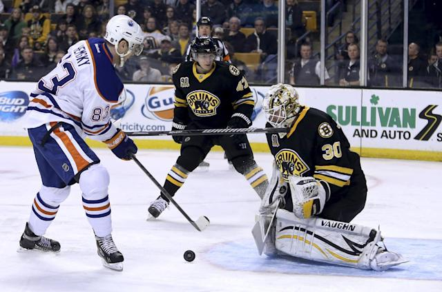 Boston Bruins goalie Chad Johnson (30) makes the save on a shot by Edmonton Oilers right wing Ales Hemsky (83), of the Czech Republic, as Boston Bruins defenseman Torey Krug (47) loses his stick during the first period of an NHL hockey game, Saturday, Feb. 1, 2014 in Boston. (AP Photo/Mary Schwalm)