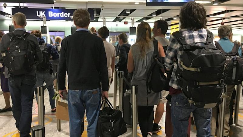 Passengers queuing at airport