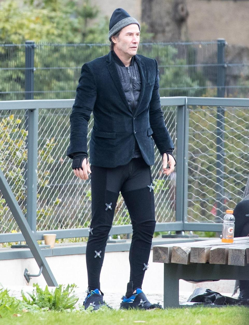 <p>Keanu Reeves takes five on the Berlin set of <em>The Matrix 4 </em>on Saturday.</p>