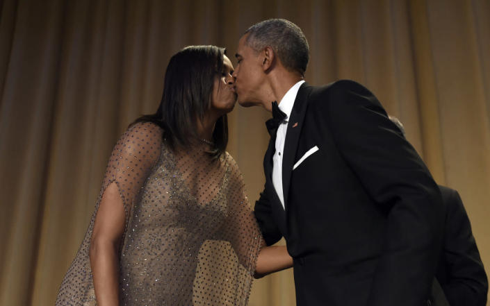 <p>President Obama kisses first lady Michelle Obama after he spoke at the annual White House Correspondents' Dinner in Washington, April 30. <i>(Photo: Susan Walsh/AP)</i></p>