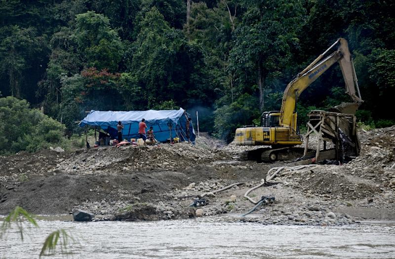 Authorities in Sumatra's Jambi province, which has one of the biggest concentrations of illegal mining sites in Indonesia, have started a determined fightback, combining a crackdown with attempts at regulation. (AFP Photo/GOH CHAI HIN)