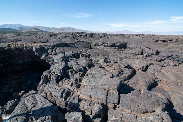 """<span class=""""caption"""">Weathering of rocks like these basalt formations in Idaho triggers chemical processes that remove carbon dioxide from the air.</span> <span class=""""attribution""""><a class=""""link rapid-noclick-resp"""" href=""""https://flic.kr/p/2hMZxfS"""" rel=""""nofollow noopener"""" target=""""_blank"""" data-ylk=""""slk:Matthew Dillon/Flickr"""">Matthew Dillon/Flickr</a>, <a class=""""link rapid-noclick-resp"""" href=""""http://creativecommons.org/licenses/by/4.0/"""" rel=""""nofollow noopener"""" target=""""_blank"""" data-ylk=""""slk:CC BY"""">CC BY</a></span>"""