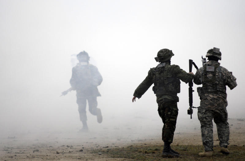 Azerbaijani and US soldiers participate in a joint NATO military exercise outside Baku on April 24, 2009 (AFP Photo/Adil Kazimov)