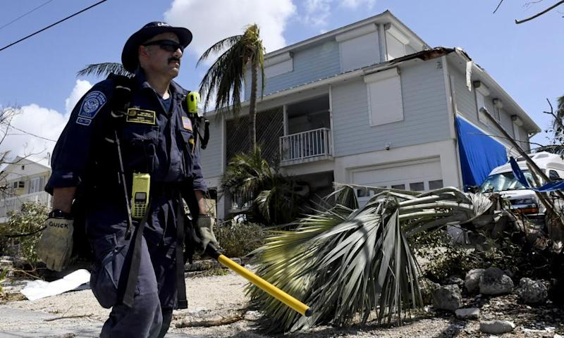 A firefighter walks towards another home looking for any signs of life in Cudjoe Key.