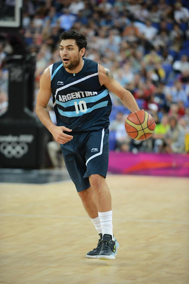 Carlos Delfino #10 of Argentina drives against Brazil during their Men's Basketball Game on Day 12 of the London 2012 Olympic Games at the North Greenwich Arena on August 8, 2012 in London, England. NOTE TO USER: User expressly acknowledges and agrees that, by downloading and/or using this Photograph, user is consenting to the terms and conditions of the Getty Images License Agreement. Mandatory Copyright Notice: Copyright 2012 NBAE (Photo by Garrett W. Ellwood/NBAE via Getty Images)