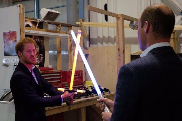 """<p>The princes tested their lightsaber skills. """"Why do I always have to be the baddie?"""" Harry asked, according to <i>People</i>. """"Come on, let's dance."""" <i>(Photo: <a href=""""https://twitter.com/KensingtonRoyal?ref_src=twsrc%5Egoogle%7Ctwcamp%5Eserp%7Ctwgr%5Eauthor"""">Twitter/Kensington Palace</a>)</i></p>"""
