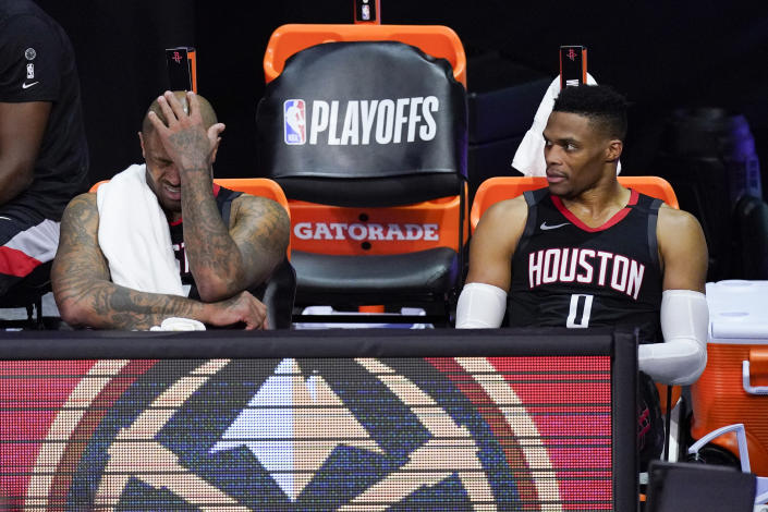 Houston Rockets' P.J. Tucker, left, and Russell Westbrook sit on the bench in the closing minutes of a loss to the Los Angeles Lakers. (AP Photo/Mark J. Terrill)
