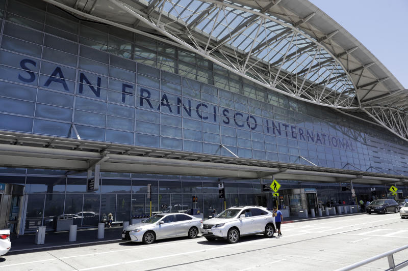 FILE - In this July 11, 2017, file photo, vehicles wait outside the international terminal at San Francisco International Airport in San Francisco. San Francisco International Airport is banning the sale of single-use plastic water bottles. The change will take effect Aug. 20, 2019 and will apply to airport restaurants, cafes and vending machines. (AP Photo/Marcio Jose Sanchez, File)