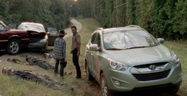 Rich and Carl on standing next to 2012 Hyundai Tucson in Season 2 of The Walking Dead