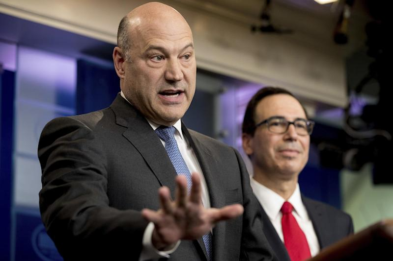 National Economic Director Gary Cohn, left, accompanied by Treasury Secretary Steve Mnuchin, speaks in the briefing room of the White House: AP
