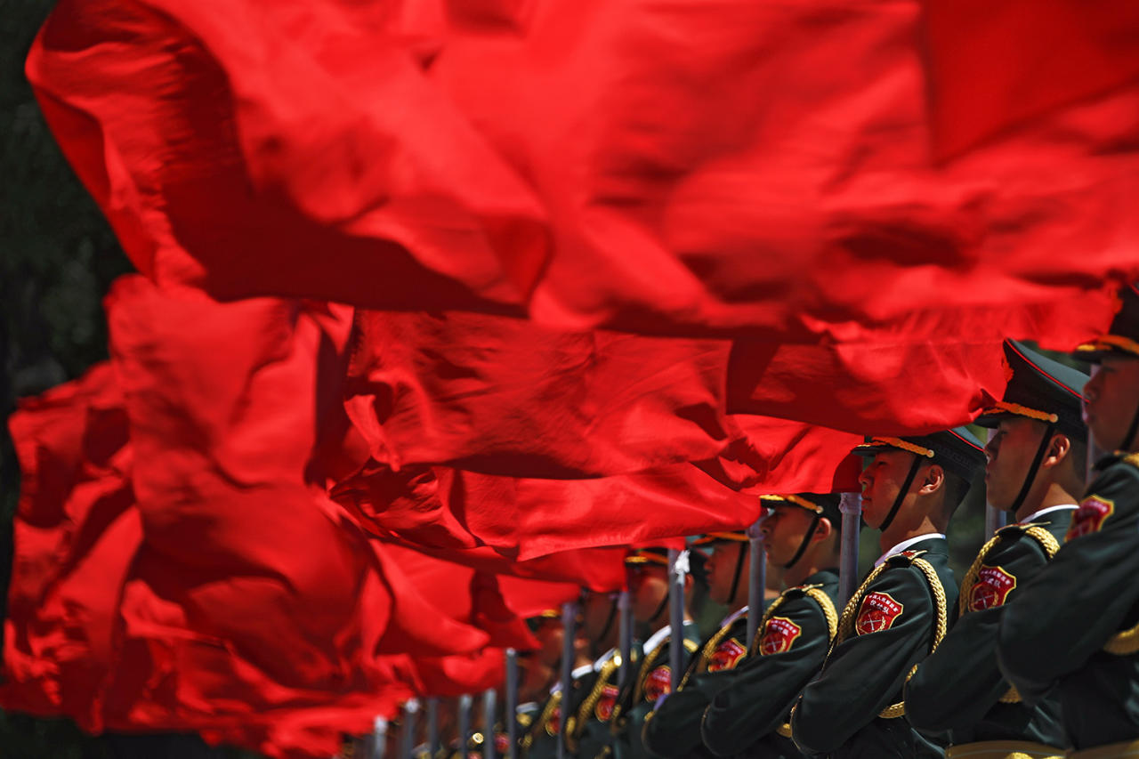 <p>Members of the honor guard hold red flags as they wait for the arrival of visiting Hungarian Prime Minister Viktor Orban during a welcome ceremony outside the Great Hall of the People in Beijing, May 13, 2017. Orban is in Beijing to attend the Belt and Road Forum on May 14-15. (Photo: Andy Wong/AP) </p>